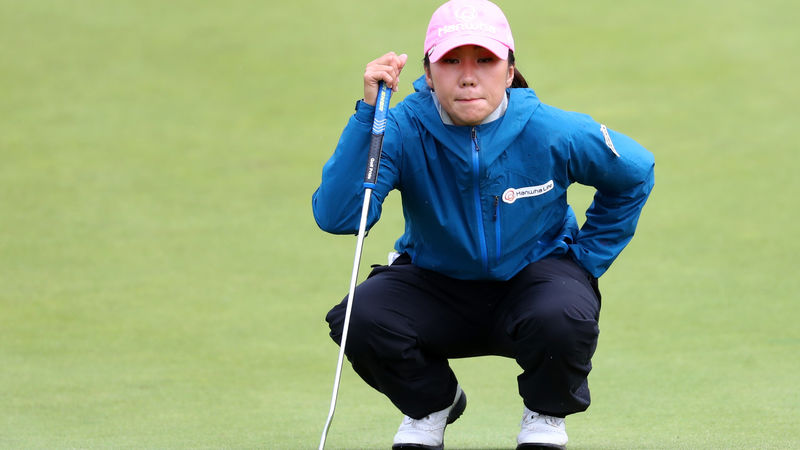Gutsy Kim holds on to win first major at British Open